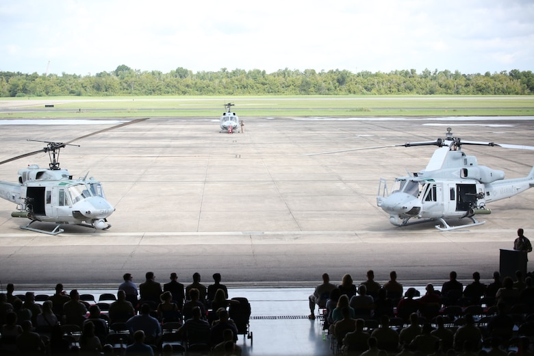 Marines, sailors and members of the community attend the final flight ceremony of the UH-1N Huey helicopter for Marine Light Attack Helicopter Squadron 773, Marine Aircraft Group 49, aboard Naval Air Station Joint Reserve Base, New Orleans, Aug. 28, 2014. The UH-1N Huey (Left) is a twin engine, utility helicopter that first flew in April 1969. The UH-1Y Venom (Right) provides drastically improved capabilities to its predecessor in terms of range, airspeed, payload, survivability and lethality.