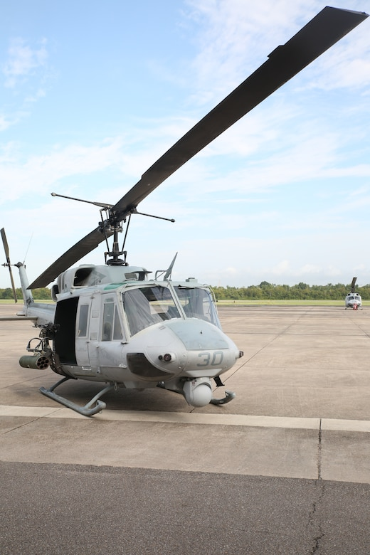 A UH-1N Huey helicopter with Marine Light Attack Helicopter Squadron 773, Marine Aircraft Group 49, is displayed for ceremony attendees to view during a final flight ceremony for the UH-1N Huey helicopter aboard Naval Air Station Joint Reserve Base, New Orleans, Aug. 28, 2014. Over the years the Marine Corps has developed a number of upgrades for the aircraft including improved avionics, aircraft survivability equipment and forward looking infrared sensors. The UH-1N Huey flew its last flight in combat in Afghanistan in 2010, it has been formally replaced by the UH-1Y Venom.