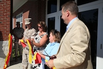 MARINE CORPS BASE CAMP LEJEUNE, N.C. – (From Left) Col. Kenneth M. DeTreux, the commanding officer of 8th Marine Regiment and native of Philadelphia, Penn., along with JoAnn L. Lyles from Sag Harbor, N. Y., Rebecca A. Yale from Meherrin, Va.,  and Christian V. Haerter  from Sag Harbor, N.Y., cut the ribbon to reopen the Yale Haerter Mess Hall, formerly the Wallace Creek Dining Hall, at a dedication ceremony to honor Cpl. Johnathan T. Yale and Lance Cpl. Jordan C. Haerter Aug. 28, 2014, aboard Marine Corps Base Camp Lejeune, N.C. Yale and Haerter died protecting their fellow Marines in Iraq when they engaged and stopped a truck loaded with 2,000 pounds of explosives before it reached its intended target in April 2008. Both Marines were posthumously awarded the Navy Cross for heroism. Rebecca Yale is the mother of Johnathan Yale and JoAnn Lyles and Christian Haerter are the parents of Jordan Haerter.  (Marine Corps photo by Lance Cpl. Michelle M. Mohn)