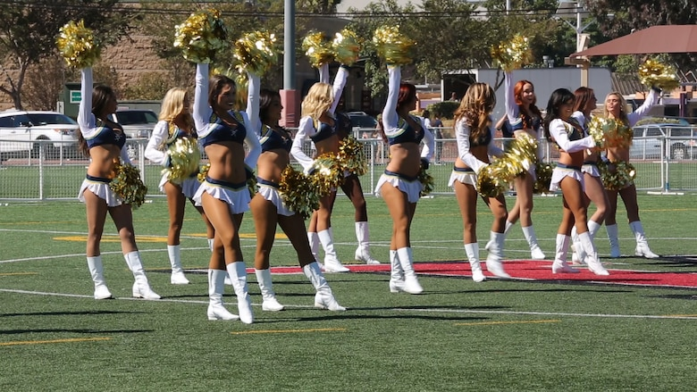 The San Diego Chargers cheerleaders dance during a military appreciation day aboard Marine Corps Air Station Miramar, Calif., Aug. 27. The cheerleaders performed before the Chargers football team arrived to practice with the Miramar Falcons.