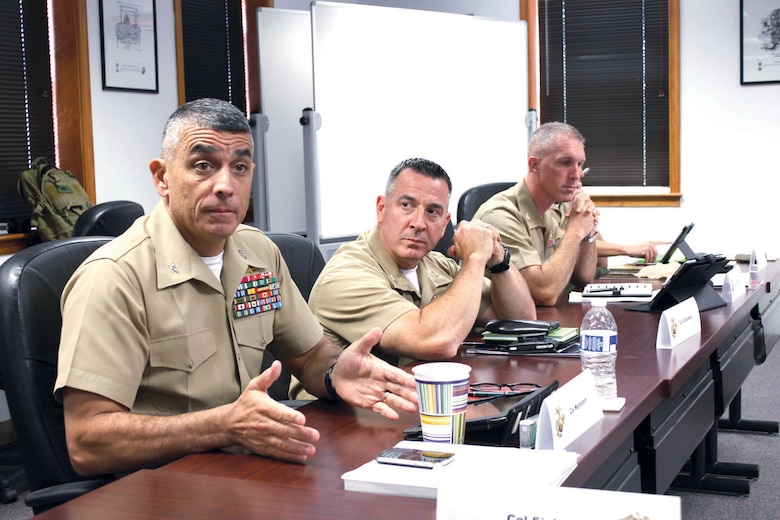 """Col. Clifford Weinstein, commanding officer, 10th Marine Regiment, 2nd Marine Division, Marine Corps Base Camp Lejeune, N.C., left, and Col. Darren Richardson, deputy commander of the 4th Marine Logistics Group, Marine Forces Reserve in New Orleans, and Col. Gerard Wynn, assistant chief of staff for operations and plans at the Marine Corps Forces Command Individual Mobilization Augmentee, engage in a discussion during the """"Senior Planners Course"""" on Aug. 20 at Marine Corps University aboard Marine Corps Base Quantico."""