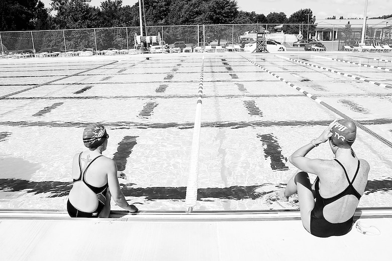 Patrons of Marine Corps Base Quantico's 50M Pool sit on the pool's edge before swimming laps Aug. 25.