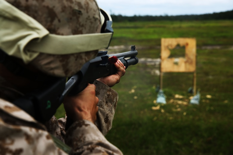 Lance Cpl. Nathan Nguyen fires a M-1014 combat shotgun during a live-fire range at Marine Corps Base Camp Lejeune, N.C., Aug. 25, 2014. Nguyen is an aviation communications technician with Marine Air Support Squadron 1.