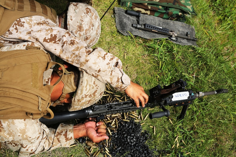 Lance Cpl. John Rueda, left, clears the chamber of a M-240B machine gun for Lance Cpl. Andy Jimenez during a live-fire range at Marine Corps Base Camp Lejeune, N.C., Aug. 25, 2014. Both Rueda and Jimenez are air support operations operators with Marine Air Support Squadron 1.