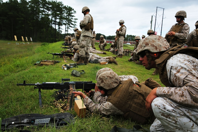 Marines with Marine Air Support Squadron 1 fire the M-240B machine gun during a live fire-range at Marine Corps Base Camp Lejeune, N.C., Aug. 25, 2014. The squadron conducted the training as a refresher for Marines with little or no hands-on experience with crew-served weapons, including the M-240B machine gun.