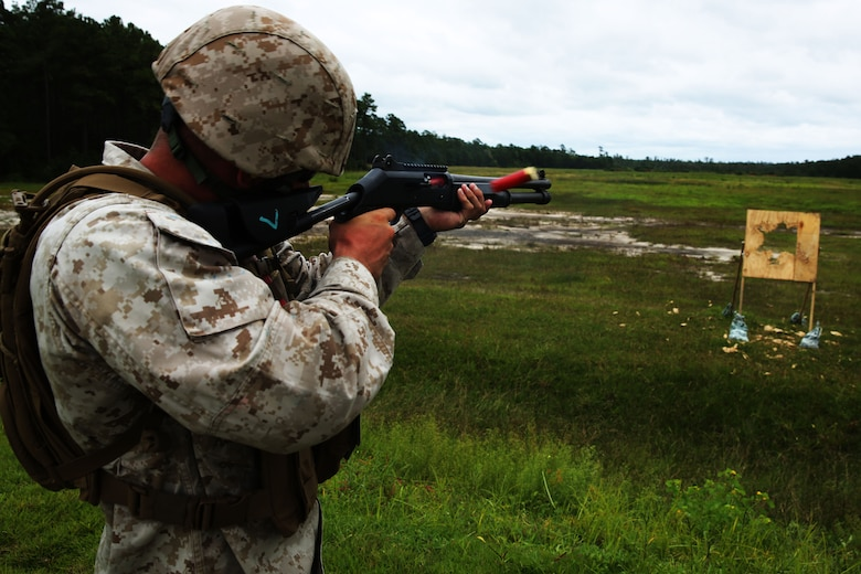 Lance Cpl. Ryan Pippen fires a M-1014 combat shotgun during a live-fire range at Marine Corps Base Camp Lejeune, N.C., Aug. 25, 2014. Pippen is an aviation communications technician with Marine Air Support Squadron 1.