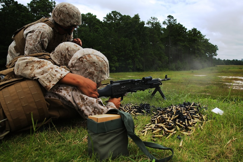 Sgt. Cody Refior, left, observes Lance Cpl. Andy Jimenez, middle, and Lance Cpl. John Rueda while they fire a M-240B machine gun at Marine Corps Base Camp Lejeune, N.C., Aug. 25, 2014. Refior is an automotive maintenance technician, and Jimenez and Rueda are air support operations operators with the squadron.