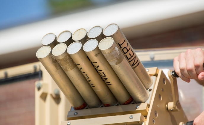 Marines with II Marine Expeditionary Force practice loading and unloading inert rounds into the Non-Lethal, Tube-Launched Munitions System during their practical application training at Camp Lejeune, North Carolina, Aug. 14, 2014. Marine Corps Systems Command Optics and Non-Lethal Systems is fielding the system that sends non-lethal munitions out as far as 500 meters and uses an audible bang to deter a crowd or a person with mal-intent. Its intended use is for military checkpoints.