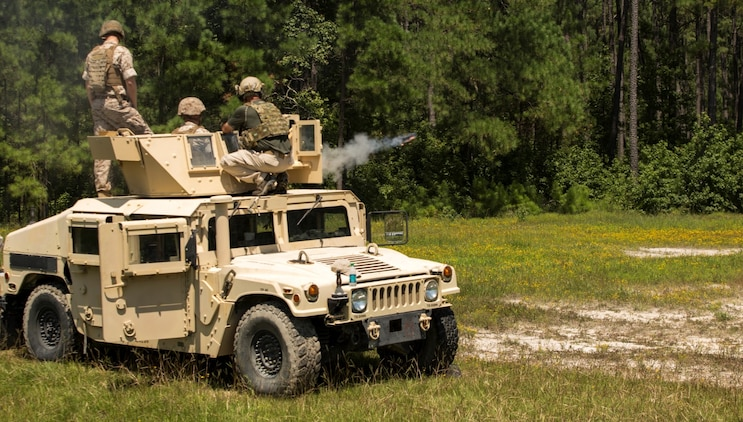 Marines with II Marine Expeditionary Force fire the Non-Lethal, Tube-Launched Munitions System from a vehicle at Camp Lejeune, North Carolina, Aug. 14, 2014. The live fire showcased the versatility and shock and awe effect of the NLTLMS and how effective it can be at a vehicle checkpoint. Marine Corps Systems Command Optics and Non-Lethal Systems is fielding the system that sends non-lethal munitions out as far as 500 meters and uses an audible bang to deter a crowd or a person with mal-intent.