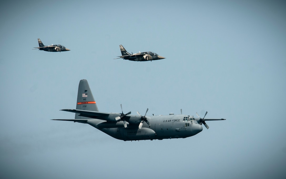 A C-130 Hercules from the 182nd Airlift Wing, Peoria, Ill., is being escorted by Canadian Alpha Jets during Operation Northern Strike 2014 near Rogers City, Mich., on Aug. 7, 2014. Operation Northern Strike 2014 is a joint multinational combined arms training exercise conducted in Michigan. (U.S. Air National Guard photo by Master Sgt. Scott Thompson)