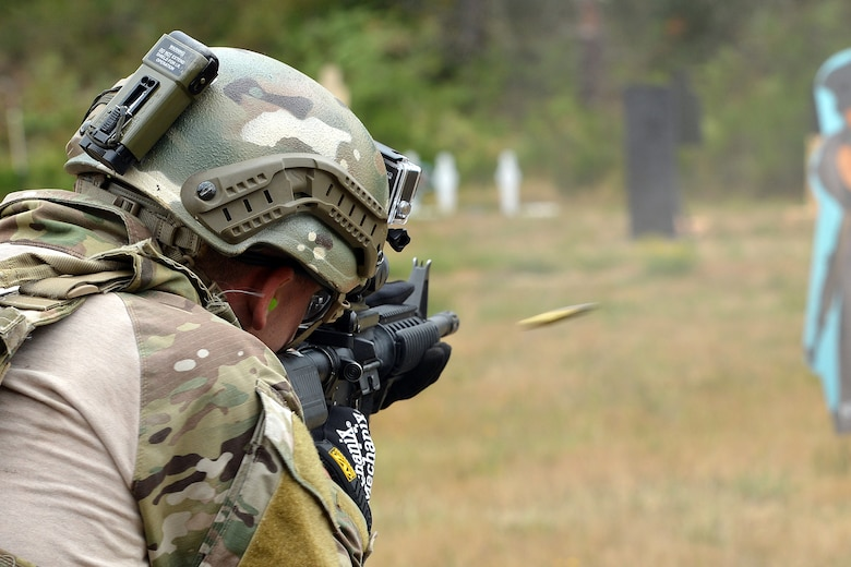 Captain Nathan Maxton, 3rd Air Support Operations Squadron tactical air control party member, fires at a moving target Aug. 20, 2014, during the Cascade Challenge at Range 103 next to North Fort Lewis at Joint Base Lewis-McChord, Wash. The participants shot the Colt M-4 carbine assault rifle and the Beretta M-9 pistol and were graded on their time of completion, and the amount of times they hit the target. (U.S. Air Force photo/Airman 1st Class Keoni Chavarria)
