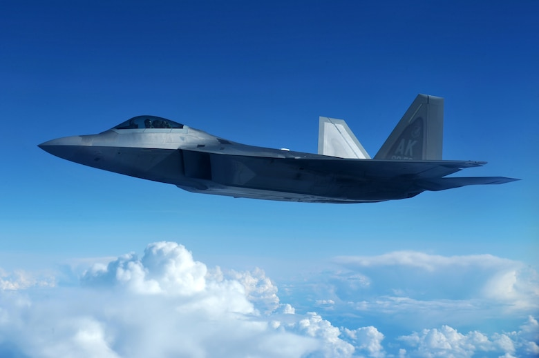 A U.S. Air Force F-22 Raptor flies over clouds during RED FLAG-Alaska 14-3 Aug. 20, 2014, at Eielson Air Force Base, Alaska. The F-22, assigned to the 90th Fighter Squadron, Joint Base Elmendorf-Richardson, Alaska, possesses a sophisticated sensor suite allowing the pilot to track, identify, shoot and kill air-to-air threats before being detected. (U.S. Air Force photo/Staff Sgt. Jim Araos)