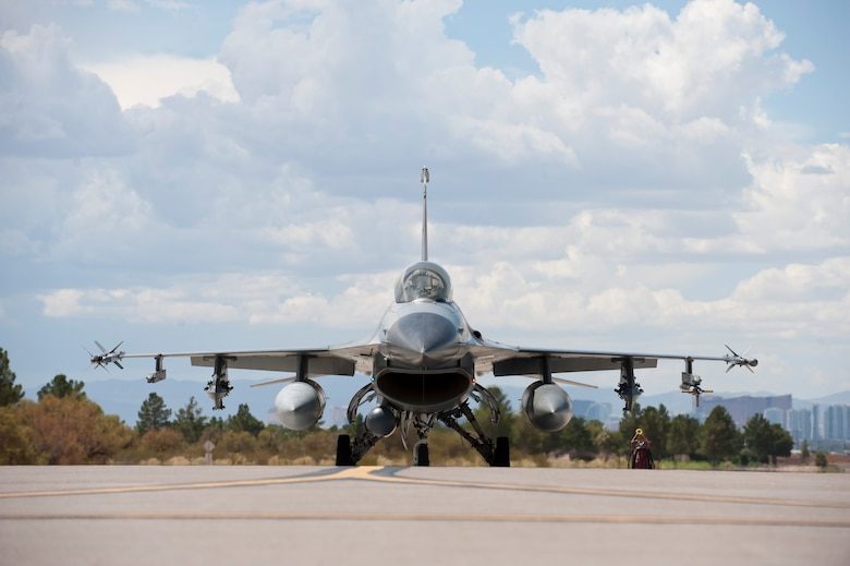 An F-16 Fighting Falcon from the 309th Fighter Squadron, Luke Air Force Base, Ariz., taxis to the runway during Green Flag-West 14-09 at Nellis AFB, Nev., Aug. 21, 2014. Green Flag exercises give visiting units the opportunity to train in air-to-ground combat operations. Many of the training exercise scenarios call for providing air support to ground troops who are participating in ground combat exercises. (U.S. Air Force photo /Airman 1st Class Thomas Spangler)