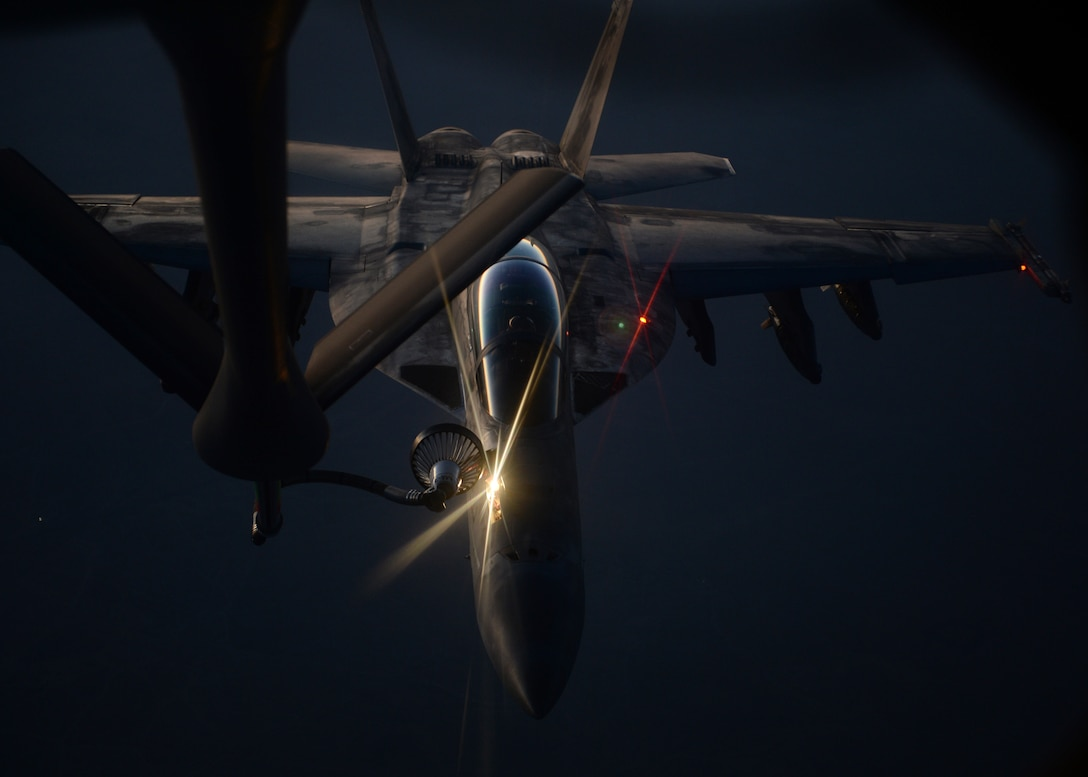 An U.S. fighter jet refuels from an Air Force KC-135 Stratotanker Aug. 21. (U.S. AirForce photo/Staff Sgt. Shawn  Nickel)
