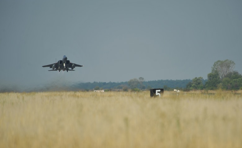 An F-15C Eagle takes off on a training mission with a Bulgarian aircraft at Graf Ignatievo Air Base near Plovdiv, Bulgaria, Aug. 21, 2014. Pilots, maintainers and a mixture of other professions from RAF Lakenheath, England, including Airmen from Ramstein Air Base, Germany will enhance interoperability with Bulgaria and maintain joint readiness. (U.S. Air Force photo/Senior Airman Hailey Haux)