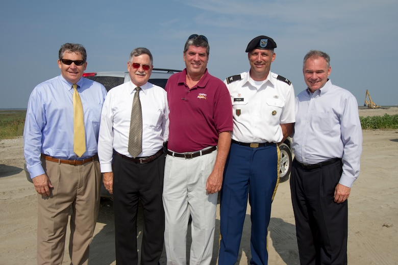 Bill Cofer (left), president of the Virginia Pilot Association, Jeff Florin, Virginia Port Authority deputy executive director, John Bull, commissioner of the Virginia Marine Resources Commission, Col. Paul Olsen, Norfolk District commander, and Senator Tim Kaine, pose for a group shot at the Norfolk District's Craney Island Dredged Material Management Area. The senator recieved a briefing about the status of the facility's expansion and its importance to the local, regional and national economy. (U.S. Army photo/Patrick Bloodgood)