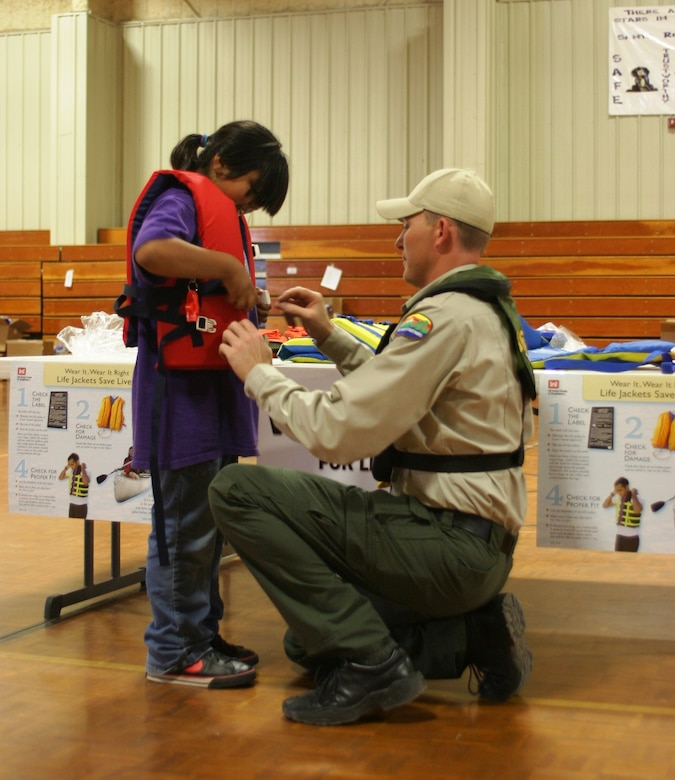 SANTA ROSA, N.M., -- A New Mexico State Parks ranger checks the fit of a life jacket on a Santa Rosa Elementary student. It's important to not only wear a life jacket, but to wear a properly fitting life jacket!