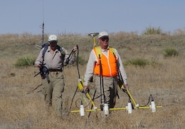 Using the metal detectors of the day, USACE contractors in 2005, look for munitions at the former Lowry Bombing and Gunnery range near Denver, Colo.