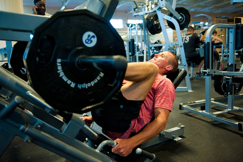 U.S. Air Force Lt. Col. Stephen Frank, instructor pilot, 559 Flying Training Squadron, performs leg press to build up his quads and lower muscle groups, 16 July, 2014, Joint Base San Antonio-Randolph, Texas. (U.S. Air Force photo by Tech. Sgt. Sarayuth Pinthong/ Released)