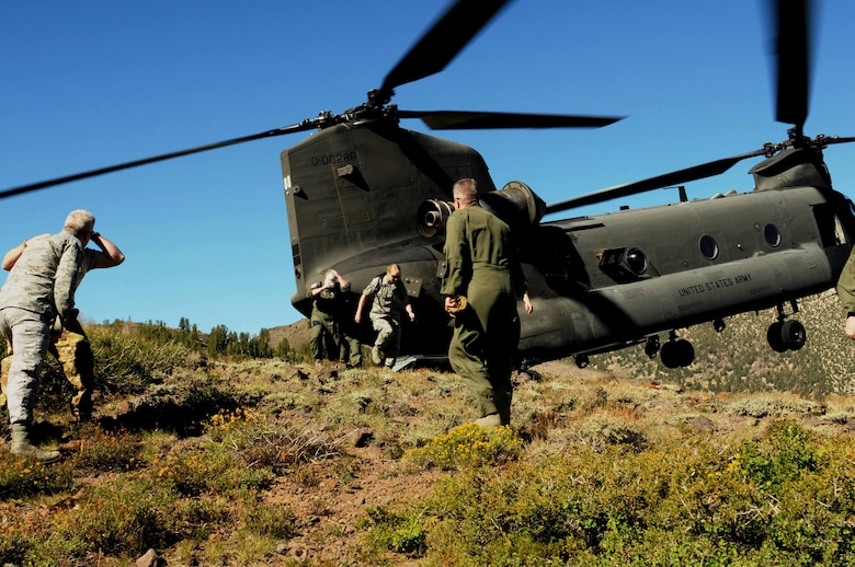 Nevada Air National Guard aircrew members participate in a refresher course on combat survival on August 16, 2014. Over 45 airmen were transported by two Nevada Army National Guard CH-47 Chinooks from the base in Reno, Nev. to the Toiyabe National Forest, near the Marine Corps' Mountain Warfare Training Center located in Pickle Meadows, Calif. (NV ANG Photo by Master Sgt. Suzanne Connell RELEASED)