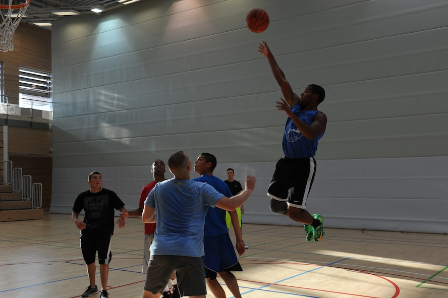 U.S. Air Force Airman 1st Class Deamontee Cawley, a 52nd Equipment Maintenance Squadron aircraft armament systems apprentice from North Kingstown, R.I., shoots a floater during the three-on-three basketball tournament for the second annual Dorm Wars competition Aug. 28, 2014, at Spangdahlem Air Base, Germany.  The teams played 15-minute games with the team leading at the end determined as the winner. (U.S. Air Force photo by Airman 1st Class Dylan Nuckolls/Released)