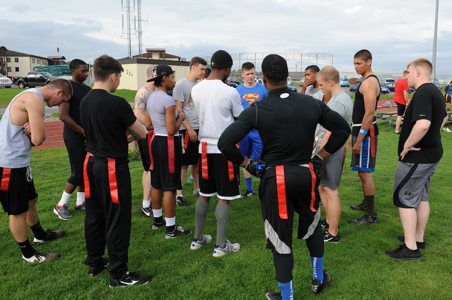 U.S. Air Force Airmen from dormitory 134 huddle during halftime of the second annual Dorm Wars competition flag football championship game Aug. 26, 2014, at Spangdahlem Air Base, Germany. Dorm 134 took home first place, winning by three touchdowns. (U.S. Air Force photo by Airman 1st Class Dylan Nuckolls/Released)