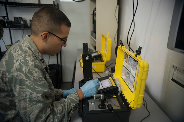 Capt. Lester Morales Vazquez, 51st Aerospace Medicine Squadron chief of bioenvironmental operations, uses a HAZMATID 360 system at Osan Air Base, Republic of Korea, Aug. 27, 2014. This device uses Fourier-Transform Infrared Spectroscopy and an extensive on-board spectral library to rapidly identify chemicals in unknown solids and liquids base on their distinct molecular fingerprints. (U.S. Air Force photo by Senior Airman Matthew Lancaster/Released)