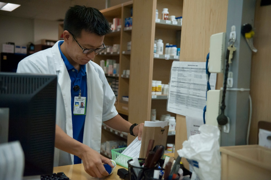 Thomas Lee, 51st Medical Support Squadron pharmacist, checks prescription labels at Osan Air Base, Republic of Korea, Aug. 27, 2014. Pharmacists check labels to make sure that patients receive the proper amount of medicine and that the dosage amount is correct. (U.S. Air Force photo by Senior Airman Matthew Lancaster/Released)