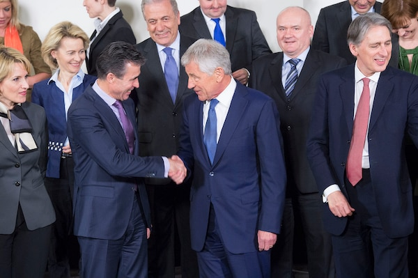 NATO Secretary General Anders Fogh Rasmussen, left, shakes hands with Defense Secretary Chuck Hagel in February 2014. NATO courtesy photo