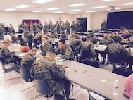 MCESG HQ sitting down to enjoy Thanksgiving luncheon