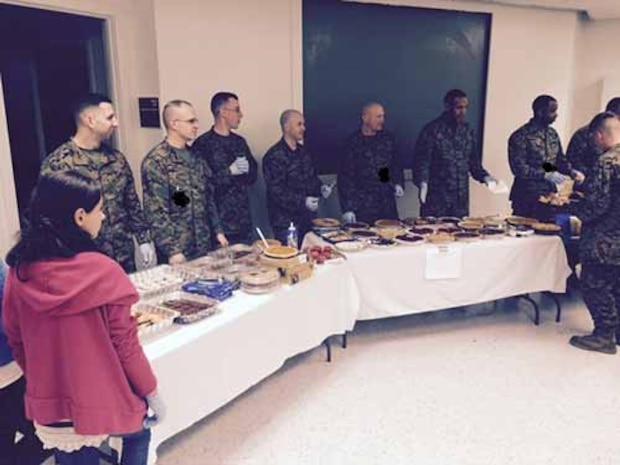 MCESG HQ staff ready to pass out Thanksgiving meal