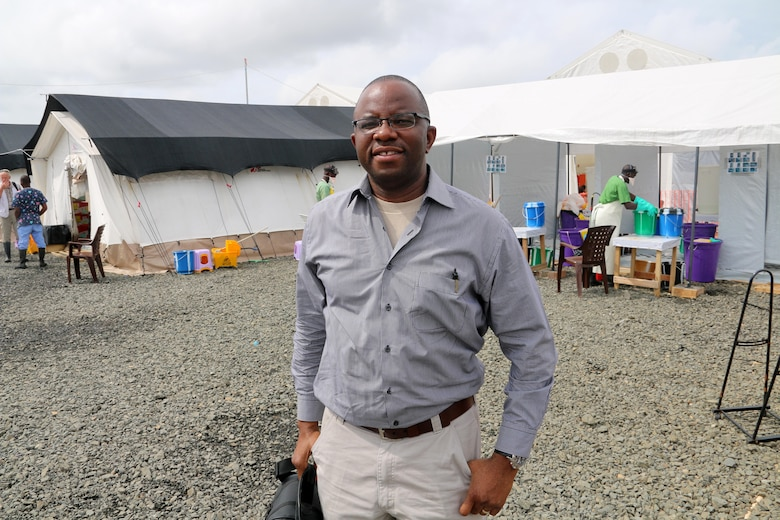 Maj. Francis Obuseh poses for a photo at a field hospital Sept. 19, 2014, in Monrovia, Liberia. Obuseh is an epidemiologist and international health specialist with the U.S. Air Forces in Europe and Air Forces Africa Surgeon General's Office and was sent to Liberia to conduct a site survey for a field hospital to be used in the fight against the epidemic Ebola outbreak there. (Courtesy photo)