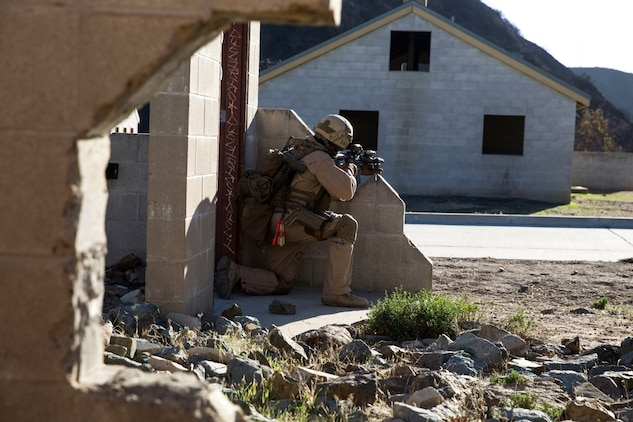 U.S. Marine Cpl. Brendan Berndt posts security during interoperability training aboard Camp Pendleton, Calif., Nov. 20, 2014. Berndt is a slack man with the 15th Marine Expeditionary Unit's Maritime Raid Force. Interop gives the 15th MEU's MRF and Security Element an opportunity to work together and support each other in preparation for a deployment in the spring. (U.S. Marine Corps photo by Cpl. Anna Albrecht/Released)
