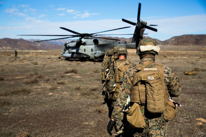 U.S. Marines with the Maritime Raid Force's Security Element, 15th Marine Expeditionary Unit, load onto a CH-53 Super Stallion during interoperability training aboard Camp Pendleton, Calif., Nov. 19, 2014. Interop gives the 15th MEU's MRF and Security Element an opportunity to work together and support each other in preparation for a deployment in the spring. (U.S. Marine Corps photo by Cpl. Anna Albrecht/Released)