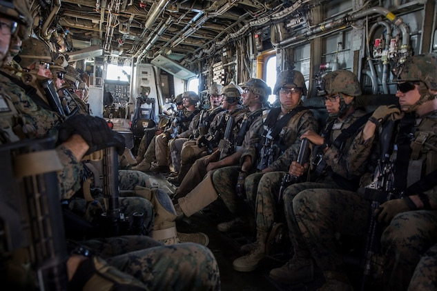 U.S. Marines with the Maritime Raid Force and Security Element of the 15th Marine Expeditionary Unit, ride in a CH-53 Super Stallion during interoperability training aboard Camp Pendleton, Calif., Nov. 20, 2014. Interop gives the 15th MEU's MRF and Security Element an opportunity to work together and support each other in preparation for a deployment in the spring. (U.S. Marine Corps photo by Cpl. Anna Albrecht/Released)