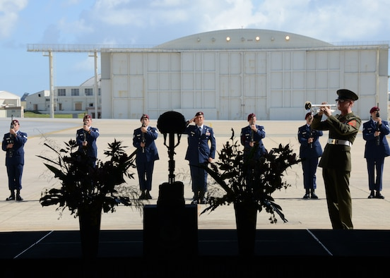 The firing party stands and salutes after conducting a three volley salute while a bugler plays Taps during a memorial service held for Tech. Sgt. Sean Barton Nov. 25, 2014 at Kadena Air Base, Japan.  Barton, a 320th Special Tactics Squadron pararescueman, died Oct. 30 from injuries sustained after a rappelling incident during a joint exercise training event near Kathmandu, Nepal.  (U.S. Air Force photo by Tech. Sgt. Kristine Dreyer)