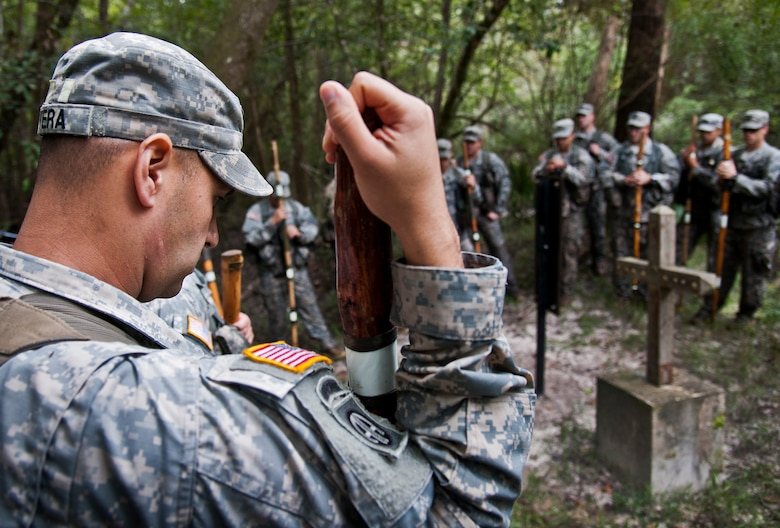 Staff Sgt. Ariel Rivera and Soldiers from the 6th Ranger Training Battalion observe a moment of silence at the memorial on Eglin Air Force Base, Fla., for the four fallen Rangers who lost their lives Feb. 16, 1995. More than 40 Soldiers participated in the excursion Sept. 25 that followed in the footsteps of the tragic squad to learn from their experience and understand what took place that night almost 20 years ago.