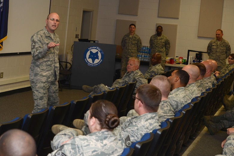 U.S. Air Force Chief Master Sgt. Charles Mills, the 20th Fighter Wing Command Chief, speaks to attendees of McEntire Joint National Guard Base's first Non-Commissioned Officer Professional Enhancement Seminar (NCOPES) with a goal of reemphasizing supervisory roles of junior NCOs assigned to the South Carolina Air National Guard's 169th Fighter Wing and the 20th Fighter Wing from Shaw Air Force Base, S.C., Oct. 28, 2014. (U.S. Air National Guard photo by Senior Master Sgt. Edward Snyder/Released)