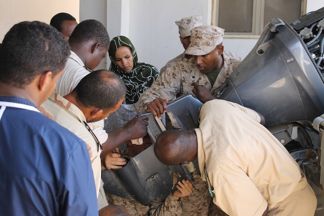 U s forces aid in mauritanian boat maintenance marine for Outboard motor repair training online