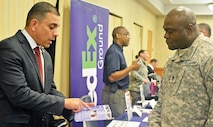 Raymond Addarich, recruiter, White House Communications Agency (left) talks with a Soldier Nov. 13 during the Steps to Success Education Expo at Riley's Conference Center.