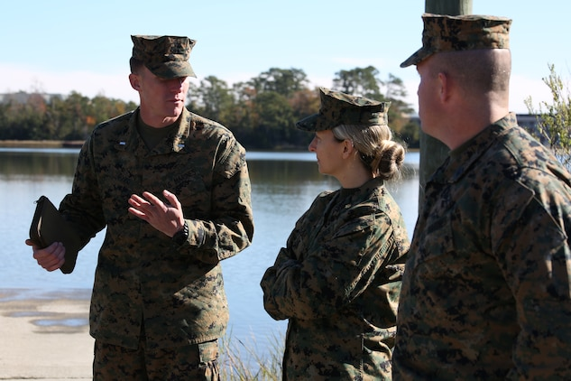 Maj. Jane Blair, center, head of research monitor team, Institutional Review Board, and Gunnery Sgt. Ethan Mahoney, right, combat engineer research monitor, IRB, are briefed on Amphibious Assault Vehicle Platoon operations by 1st Lt. Robert S. Dyer, left, platoon commander, AAV Platoon, Company B, Ground Combat Element Integrated Task Force, at the 2nd Assault Amphibian Battalion Ramp at Marine Corps Base Camp Lejeune, North Carolina, Nov. 19, 2014. The research monitor team is responsible for observing daily training and operations and ensuring the ethical treatment of research subjects. (U.S. Marine Corps photo by Cpl. Paul S. Martinez/Released)