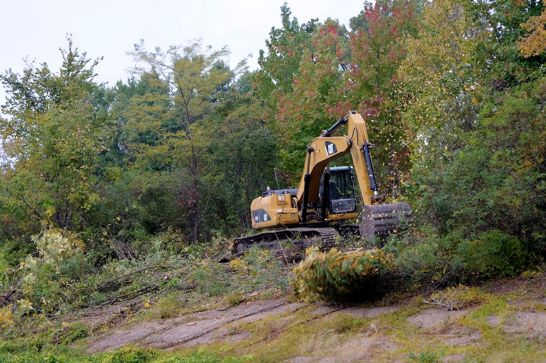 Removing vegetation that has encroached upon the work site. (USACE Photo/Brenda Beasley)