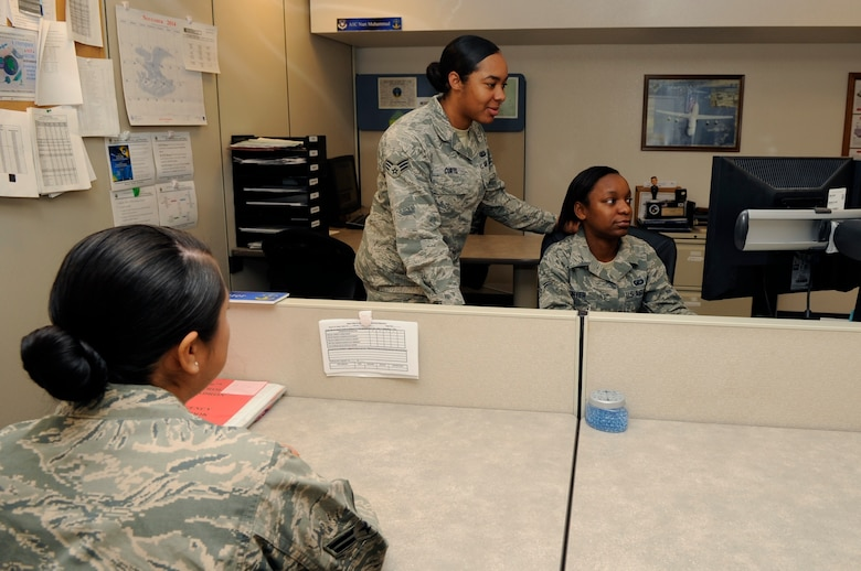 Senior Airman Ernestine Curtis, 30th Comptroller Squadron lead defense travel administrator, and Airman 1st Class Kiera Hunter, 30th CPTS customer service technician, provide financial assistance to Airman 1st Class Vapsi Rubio, 30th Force Support Squadron personnel, Nov. 28, 2014, Vandenberg Air Force Base, Calif. CPTS leadership understands while their team isn't providing Close Air Support, their diligence aims to ensure financial distractions don't impede overall mission success. (U.S. Air Force photo by Senior Airman Shane Phipps/Released)