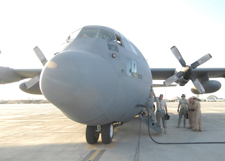 A loadmaster on a Delaware Air National Guard C-130 gives a hand to an Airman leaving Bagram Airfield, Afghanistan, Oct. 18, 2009. (U.S. Air Force photo by Senior Airman Susan Tracy)