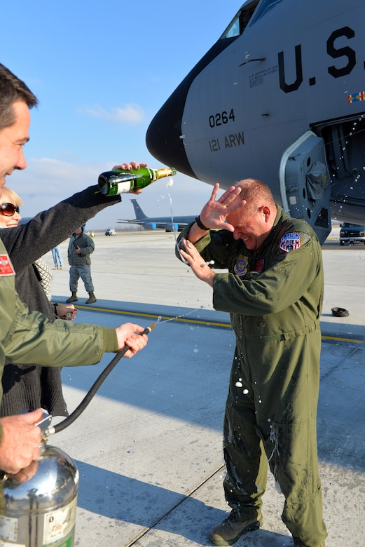 Chief Master Sgt. Tom Guard, a boom operator in the 121st Air Refueling Wing, receives a shower after his final flight  Nov. 26, 2014, at Rickenbacker Air National Guard Base, Ohio. Guard served 41 years in the military and is set to retire on Dec. 19, 2014.  (U.S. Air National Guard photo by Master Sgt. Ralph Branson/Released)