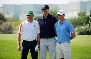 Air Force SMSgt Spencer Mims (center) wins the Men's Senior Division gold medal.  The US Men and Women Armed Forces Golf teams won respective gold medals for the seventh time during the 8th CISM World Military Golf Championship held in Bahrain 13-21 November 2014.