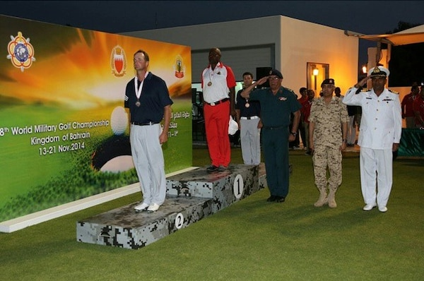 Army Spec. Jordan-Tyler Massey (left) and Capt. Joseph Cave (second from left) win the CISM Men's silver and bronze respectively in the open division.  The US Men and Women Armed Forces Golf teams won respective gold medals for the seventh time during the 8th CISM World Military Golf Championship held in Bahrain 13-21 November 2014.