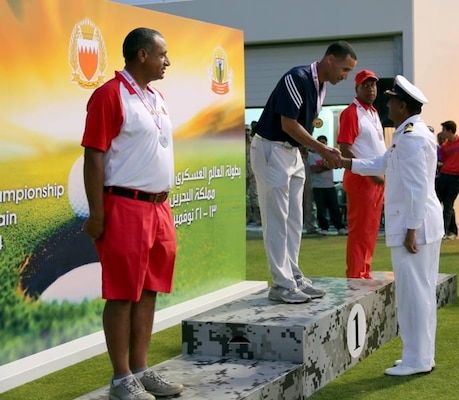 Air Force Sen. Master Sgt. Spencer Mims captures the Men's Senior Division gold medal.  The US Men and Women Armed Forces Golf teams won respective gold medals for the seventh time during the 8th CISM World Military Golf Championship held in Bahrain 13-21 November 2014.