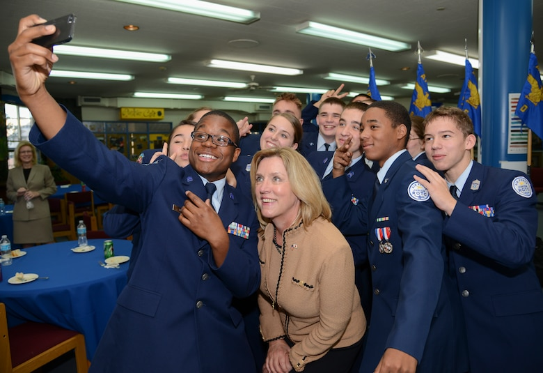 Secretary of the Air Force Deborah Lee James takes a selfie with Junior ROTC Cadets Nov. 21, 2014, at Yokota's High School at Yokota Air Base, Japan. Along with having lunch and getting to know the cadets, James participated in a question and answer session. Secretary James visited Yokota AB to discuss the future of the Air Force and as well as meet Airmen serving in the region. (U.S. Air Force photo/Senior Airman Michael Washburn)