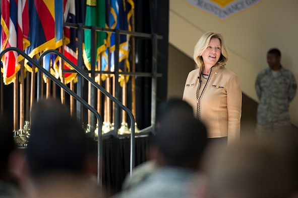 Secretary of the Air Force Deborah Lee James looks to the crowd before speaking to Airmen Nov. 21, 2014, at Yokota Air Base, Japan. James had multiple stops on her trip before coming to Japan, and will continue her journey throughout the Pacific after leaving Yokota AB. (U.S. Air Force photo/Staff Sgt. Cody H. Ramirez)